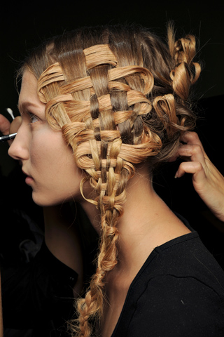 The braided hairstyle pairs to the harvest inspirations