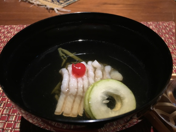 Light bouillon with fish fillet, cucumber and ume paste
